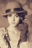 Beautiful women with magnifying glass. Stock Image
