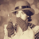 Beautiful women with magnifying glass. Royalty Free Stock Photo