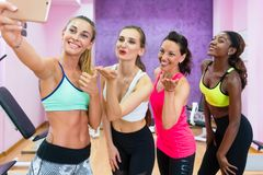 Beautiful women making a selfie to share the joy of a healthy living. Four happy and beautiful women making a group selfie, to share with their virtual friends Royalty Free Stock Image