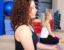Beautiful women meditating Royalty Free Stock Image