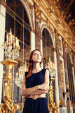 Beautiful women in mirror's hall. Beautiful woman in mirror's hall of Versailles Chateau. France Stock Photo