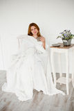 Beautiful women with morning coffee sitting in white chair Royalty Free Stock Photography