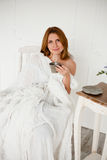 Beautiful women with morning coffee sitting in white chair Royalty Free Stock Photo