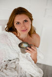 Beautiful women with morning coffee sitting in white chair Stock Photos