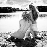 Beautiful women near the lake Stock Photo