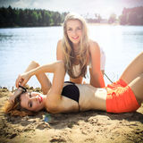 Beautiful women near the lake Royalty Free Stock Photo