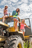 Beautiful women on old big tractor Stock Photography
