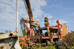 Beautiful women on old harvester in farm Stock Photo