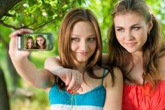 Beautiful women outdoors taking images Stock Photo