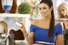 Beautiful woman paying by credit card Royalty Free Stock Photos