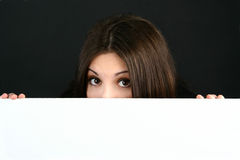 Beautiful women peeking. Over the edge Royalty Free Stock Photography