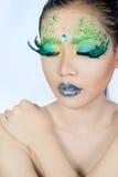 Beautiful women with perfect art make up and long false eyelashe Royalty Free Stock Photography
