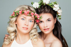 Beautiful Women with Permed Hairstyle. Makeup and Flowers. Young Beauty Royalty Free Stock Photography