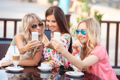 Beautiful women, photographing a phone Stock Photo