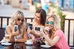 Beautiful women, photographing a phone Stock Image