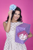 Beautiful women in pink background with present. Party. Love. Gift. Stock Image