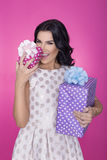 Beautiful women in pink background with present. Party. Love. Gift. Royalty Free Stock Photos