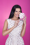 Beautiful women in pink background with present. Party. Love. Gift. Stock Images