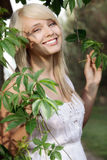 Beautiful women in plants. Young beautiful woman in plants royalty free stock image