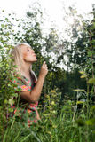 Beautiful women in plants Stock Photo