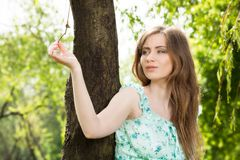 Beautiful women in plants Stock Photos