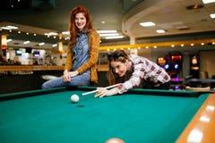 Beautiful women playing billiards. Beautiful smiling women playing billiards at a bar Stock Photo