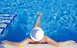 Beautiful Women in the pool Stock Images