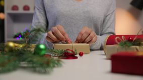 Beautiful women preparing Christmas presents. Holiday and Christmas concept. Wrapped Christmas gifts stock footage
