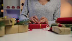 Beautiful women preparing Christmas presents. Holiday and Christmas concept. Wrapped Christmas gifts stock video