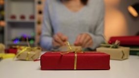 Beautiful women preparing Christmas presents. Holiday and Christmas concept. Wrapped Christmas gifts stock video footage