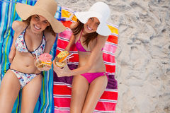 Beautiful women raising their cocktails together Stock Photo
