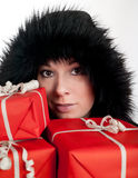 Beautiful women with red gift boxes Stock Image