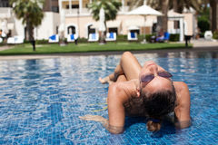 Beautiful women relaxing at the luxury poolside. royalty free stock images