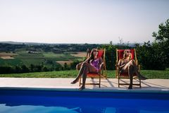 Women relaxing and sunbathing in summer. Beautiful women relaxing and sunbathing in summer stock photos