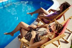 Women relaxing and sunbathing in summer. Beautiful women relaxing and sunbathing in summer royalty free stock photos