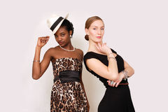 Beautiful women in retro fashion. Two beautiful women in retro Sunday fashion, horizontal composition with copy space Royalty Free Stock Images