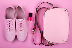 Beautiful women's minimal set of fashion accessories on a pink background Royalty Free Stock Photo