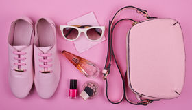 Beautiful women's minimal set of fashion accessories on a pink background Royalty Free Stock Images