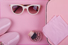 Beautiful women's minimal set of fashion accessories on a pink polka dots background Stock Image