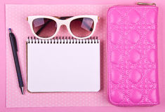 Beautiful women's minimal set of fashion accessories on a pink polka dots background Stock Photo