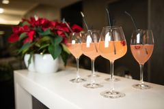 Cocktails on spot in beauty salon. Welcome drinks. Holiday party. Beautiful women`s welcome drinks with raspberries and black tubules in luxury beauty salon royalty free stock photo