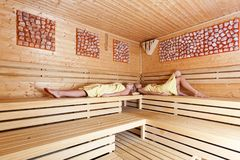 Beautiful women in a sauna. royalty free stock image