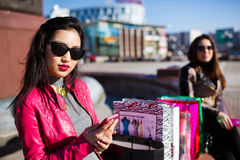 Beautiful Women Sending Messages with Mobile. Beautiful asian women sending messages with mobile phone outdoor Royalty Free Stock Photo