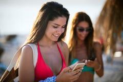 Beautiful women in sexy bikini standing at sea beach royalty free stock photos