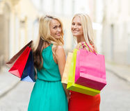 Beautiful women with shopping bags in the ctiy Stock Photos