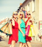 Beautiful women with shopping bags in the ctiy Stock Photo