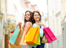 Beautiful women with shopping bags in the ctiy Royalty Free Stock Photo