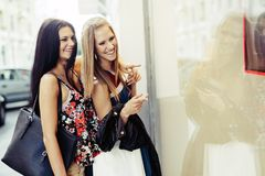 Beautiful women shopping spree. On street stock photography