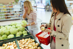Beautiful women shopping vegetables and fruits Royalty Free Stock Photography