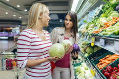 Beautiful women shopping vegetables and fruits Stock Images